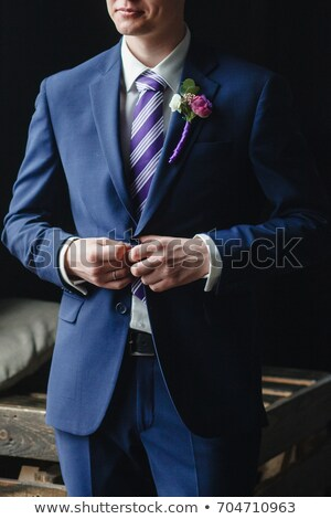 Elegant Man Fixing Cuffs his Button Down Shirt Stock photo © filipw