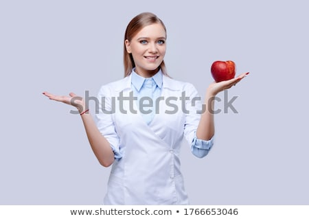 female doctor eating apple stock photo © is2