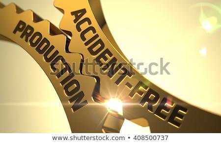 Accident-Free Production Concept. Golden Metallic Gears. Stock photo © tashatuvango
