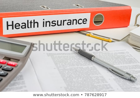 an orange folder with the label health insurance stock photo © zerbor