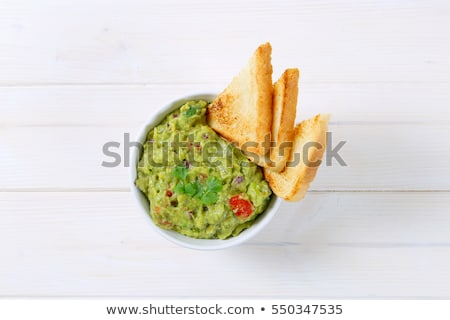 bowl of guacamole with toast Stock photo © Digifoodstock