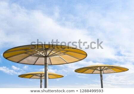Három citromsárga kék ég utazás esernyő kint Stock fotó © IS2