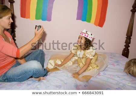Mother photographing daughter dressed up in princess costume Stock photo © IS2