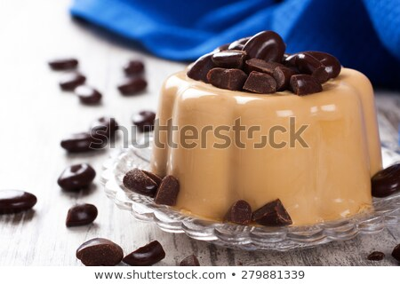 Coffee panna cotta with chocolate candies Stock photo © Melnyk