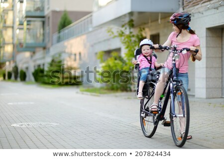 Girl Getting Ready to Ride Bike Stock photo © 2tun