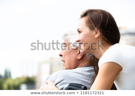 Woman With Her Disabled Father Near Railing Stock photo © AndreyPopov