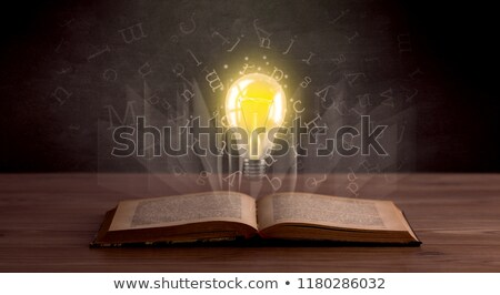 Letters and lightbulb over book  Stock photo © ra2studio