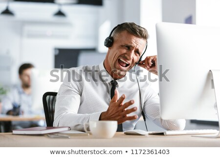 Foto nerveus zakenman 30s kantoor Stockfoto © deandrobot