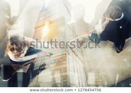rival · homem · de · negócios · mulher · comando · corda - foto stock © alphaspirit