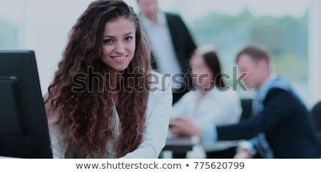 Portrait Of Happy Businessman Smiling In Coworking With Colleagues Stock photo © diego_cervo