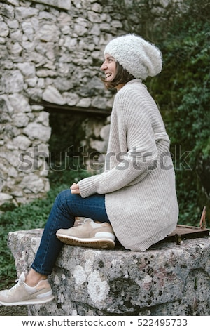 fashionable and swag look of woman wearing in beige stock photo © studiolucky
