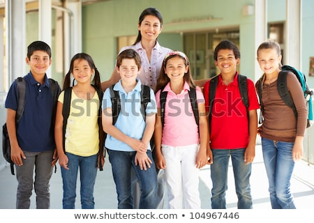 Pre teen school children with teacher outside Stock photo © Lopolo