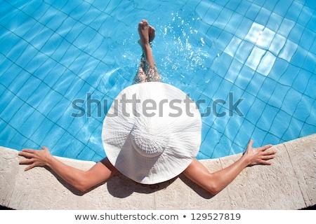 Mulher jovem relaxante piscina topo ver cópia espaço Foto stock © karandaev