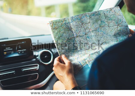 Male tourist with map and backpack stock photo © colematt
