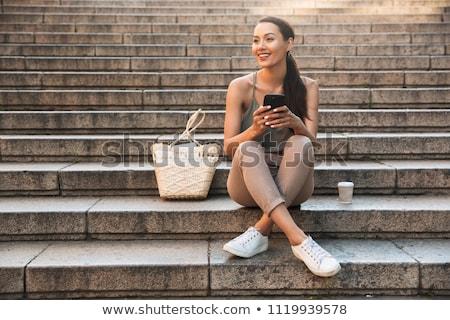 Uśmiechnięty asian dziewczyna posiedzenia schody odkryty Zdjęcia stock © deandrobot
