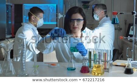 Woman examining chemical reaction Stock photo © pressmaster
