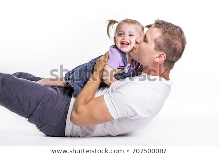 Stock photo: Father and daughter lay on ground having fun