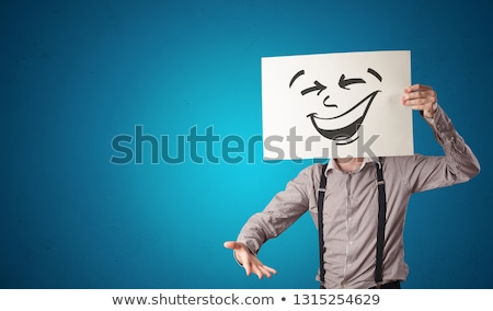 Person holding a paper with cool emoticon face Stock photo © ra2studio