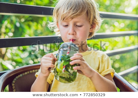 Water with mint and lime. Drink more water concept Stock photo © galitskaya