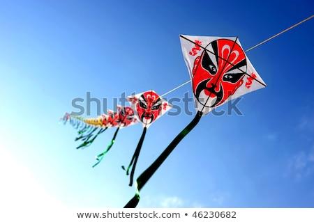 piros · papírsárkány · repülés · madár · kék · toll - stock fotó © galitskaya