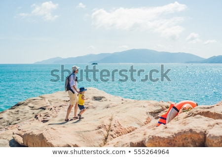 Father and son travelers at the Hon Chong cape, Garden stone, popular tourist destinations at Nha Tr Stock photo © galitskaya