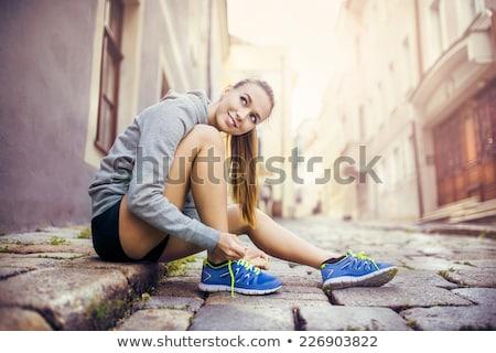 Genç kadın koşucu eski şehir Stok fotoğraf © Lopolo