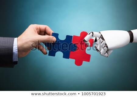 Robot And Man's Hand Joining Jigsaw Pieces Stock photo © AndreyPopov