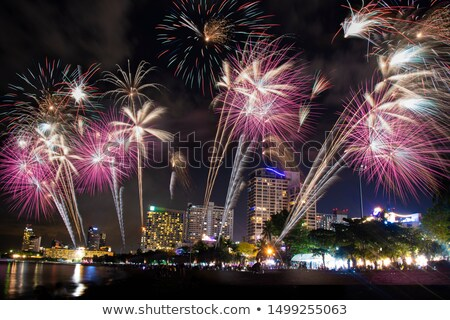 Elképesztő tűzijáték város színes gyönyörű tájkép Stock fotó © jossdiim
