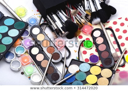 Eyeshadow palette and make-up brush on orange background, eye sh Stock photo © Anneleven