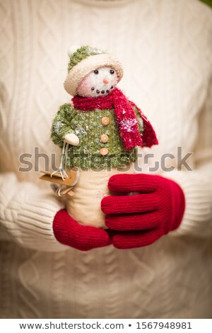 Woman Wearing Seasonal Red Mittens Holding Christmas Snowman Stock photo © feverpitch
