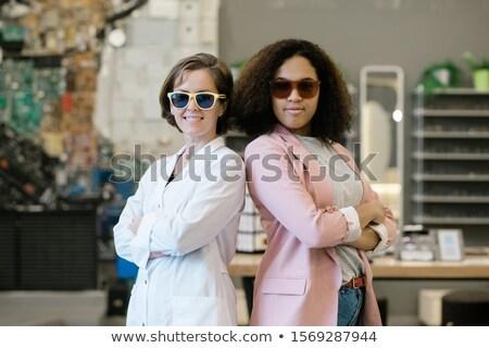 Kettő fiatal multikulturális nők napszemüveg áll Stock fotó © pressmaster