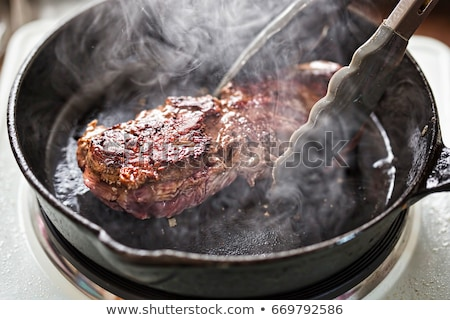 Beef steak in the frying pan Stock photo © Alex9500