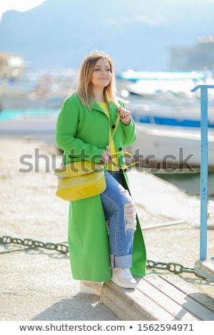 Nő évek öreg hosszú zöld kabát Stock fotó © ElenaBatkova
