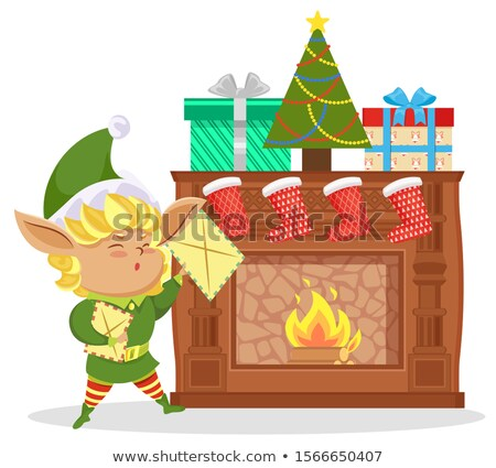 Xmas Elf Hold Boxes with Gifts, Fireplace in Room Stock photo © robuart