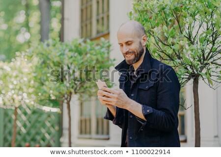 Positief kaal jonge zakenman donkere baard Stockfoto © vkstudio