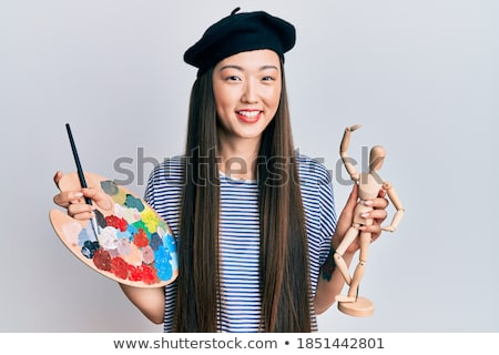Image of young asian girl wearing beret laughing and showing oka Stock photo © deandrobot