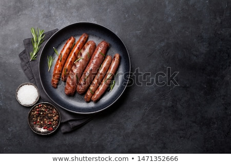 Grilled sausages on rustic plate Stock photo © Alex9500
