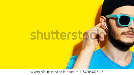 Young man with sunglasses and headphones touch glasses Stock photo © Paha_L