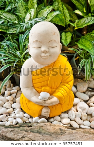 Earthenware of child monk isolated on white background Stock photo © Archipoch