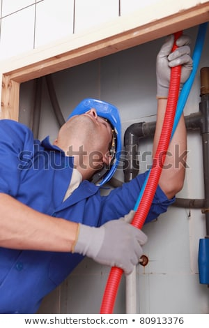 Skilled technician repairing canalizations Stock photo © photography33