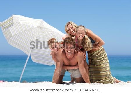 Retrato mulher jovem guarda-sol praia sol cabelo Foto stock © HASLOO