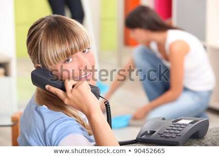 A teenage girl answering the phone at her place. Stock photo © photography33