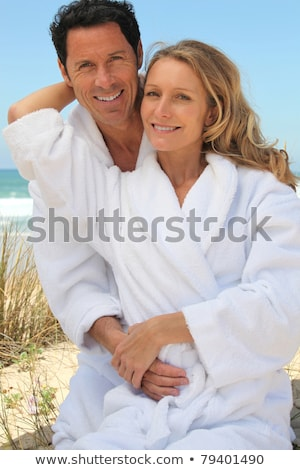couple in robes on the beach Stock photo © photography33