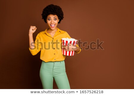 Stock photo: happy woman wearing football shirt holding football
