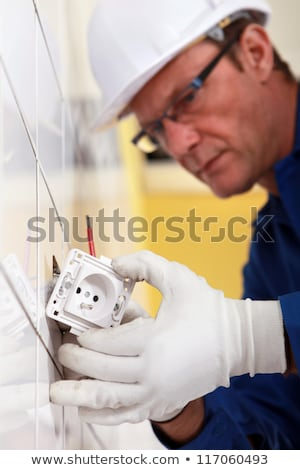 Electrician fitting electrical outlet Stock photo © photography33