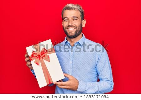 jóképű · férfi · ajándék · portré · elegáns · férfi · fehér - stock fotó © Rustam