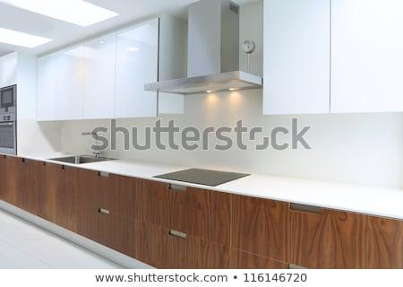 Actual modern kitchen in white and walnut wood Stock photo © lunamarina