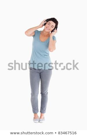 kadın · müzik · beyaz · gülümseme · yüz - stok fotoğraf © wavebreak_media