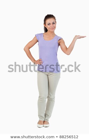 Young female presenting with her palm lifted against a white background Stock photo © wavebreak_media
