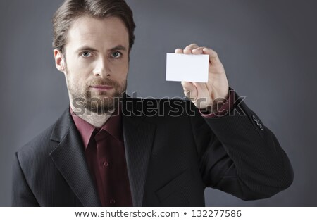 Good-looking man holding business card Stock photo © konradbak